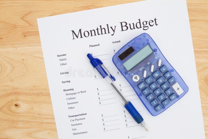 Het creëren van een uw maandelijkse begroting stock afbeelding