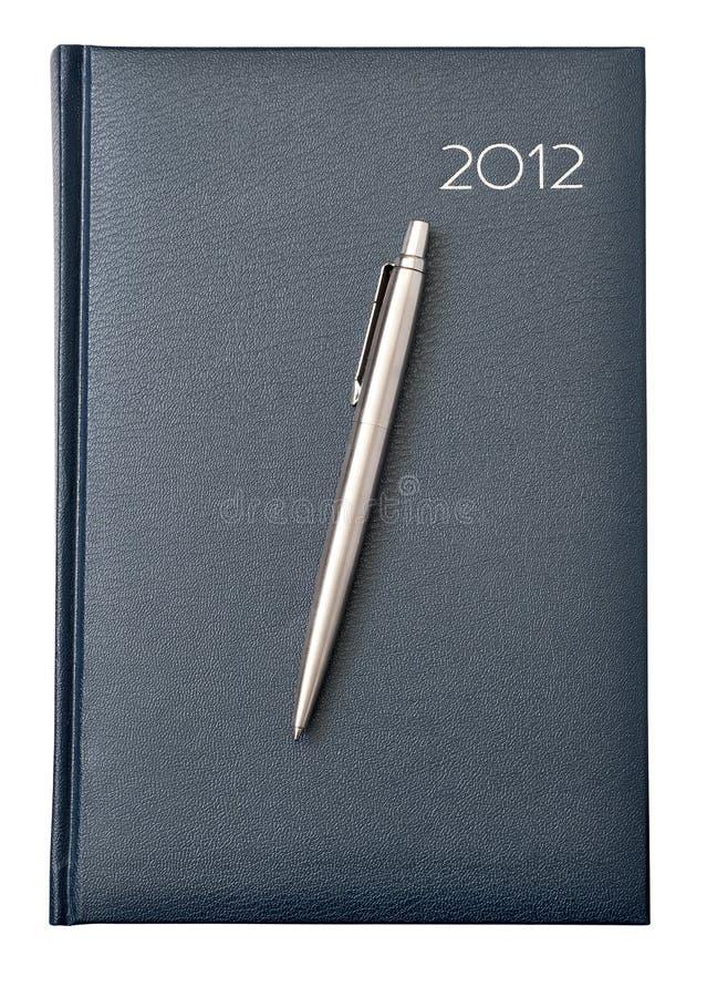 Het dagelijkse logboek met een pen stock foto's