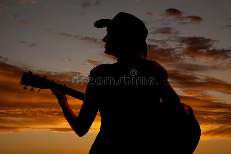 Het de gitaarsilhouet van de vrouw kijkt linker royalty-vrije stock foto