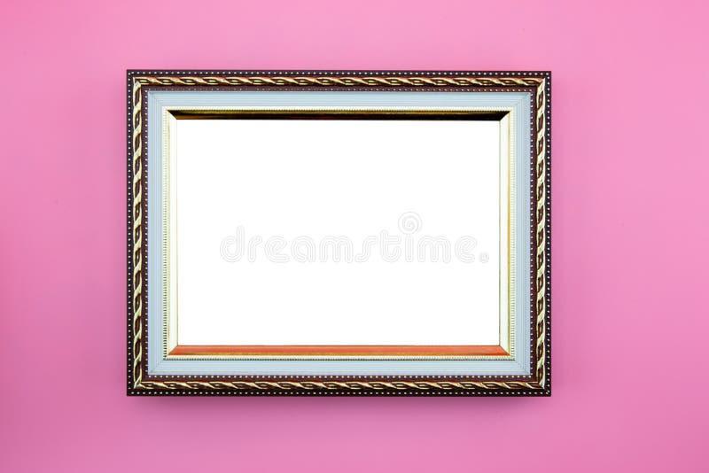 Het de gouden grens of beeld van de kaderfoto met exemplaarruimte op roze achtergrond, de galerij van het portretbeeld royalty-vrije stock fotografie
