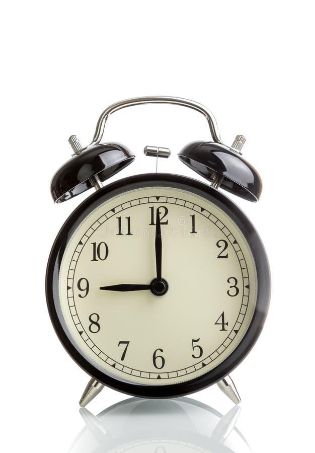 Het de klok van ` s negen o ` reeds, tijd om voor ontbijt, uitstekende oude zwarte metaalwekker te ontwaken stock afbeelding