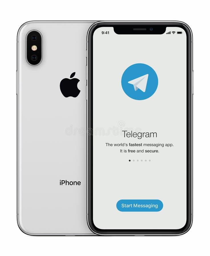 Het de lanceringsscherm van de telegramboodschapper met Telegramembleem op Apple-iPhone X vertoning royalty-vrije stock foto's
