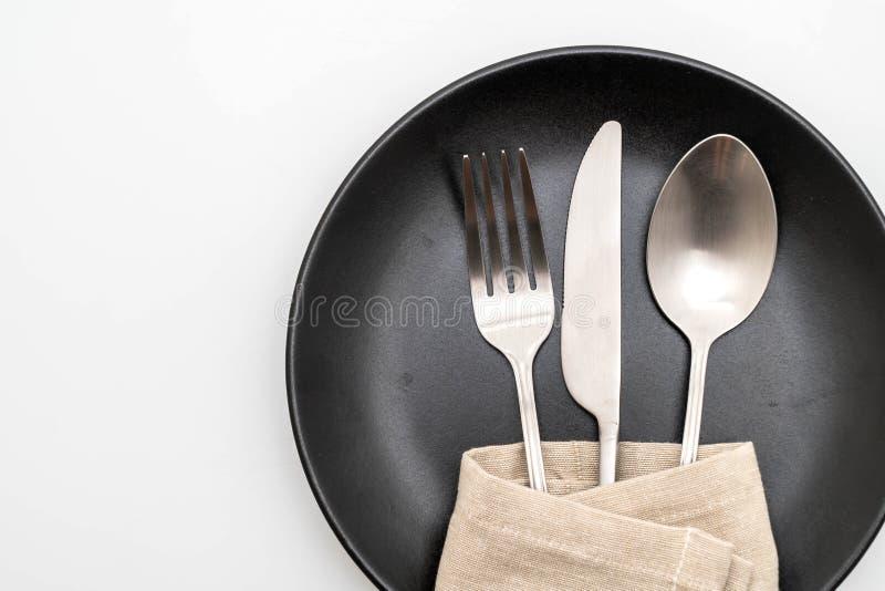 het de lege vork en mes van de plaatlepel royalty-vrije stock fotografie
