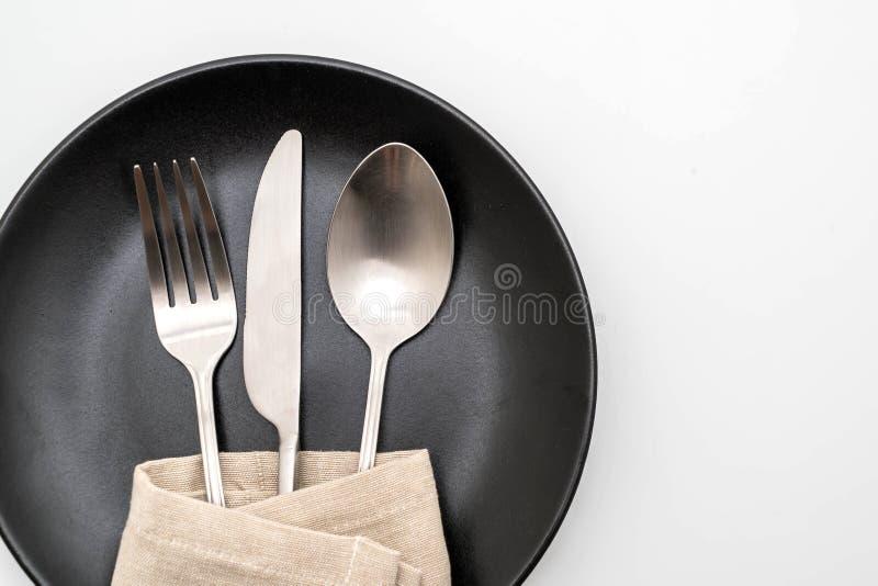 het de lege vork en mes van de plaatlepel stock afbeelding