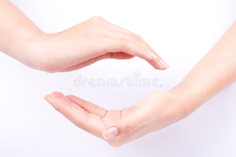 Het de symbolenconcept van de vingerhand sluit zich aan bij twee tot een kom gevormde handen en kan de kracht met u op witte acht royalty-vrije stock foto