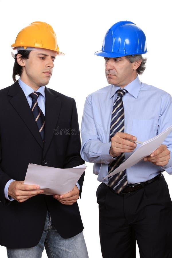 Het debatteren van zakenlieden stock foto's