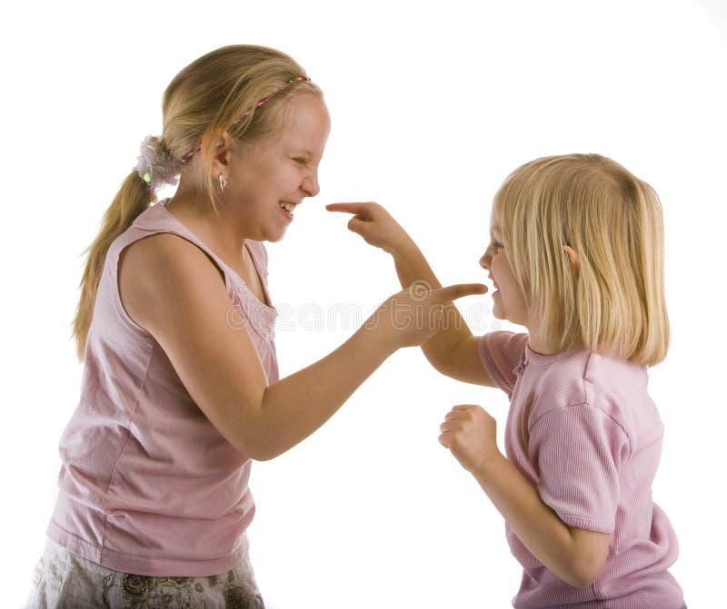 Het Debatteren van zusters stock afbeelding