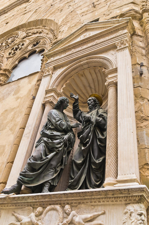 Het detail van Christus en van Heilige Thomas van Orsanmichele-kerk in Florence, Toscanië stock fotografie