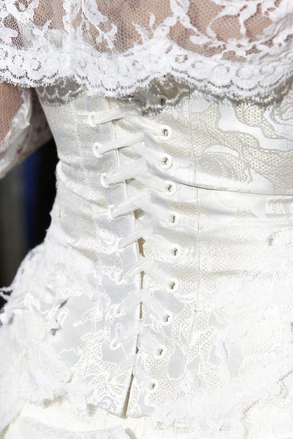 Het detail van de het huwelijkskleding van de bruid stock foto