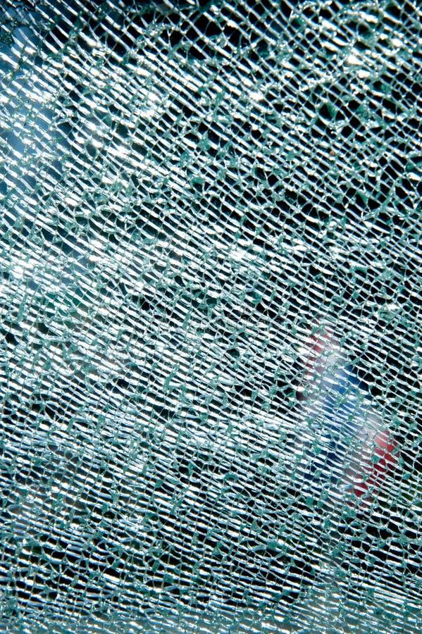 Het deurglas is gebroken stock afbeeldingen