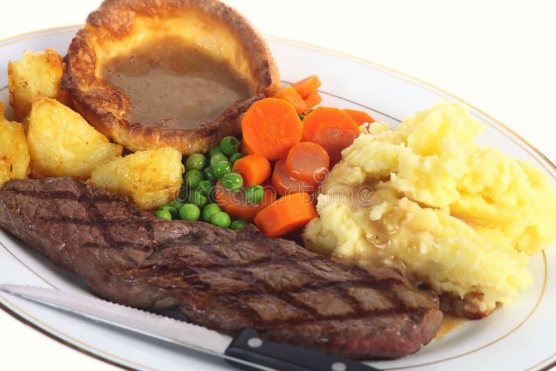 Het diner van het lapje vlees met jus stock fotografie