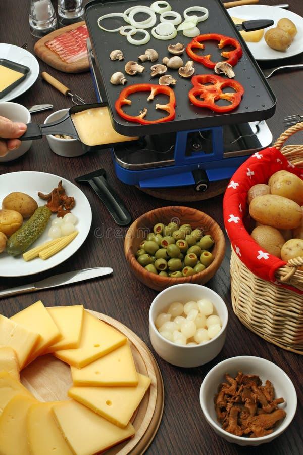 Het diner van Raclette stock fotografie