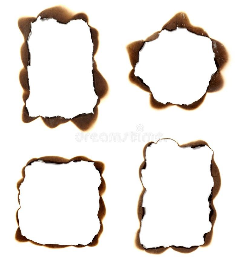 Het document van de brandwond frame achtergrond stock afbeeldingen