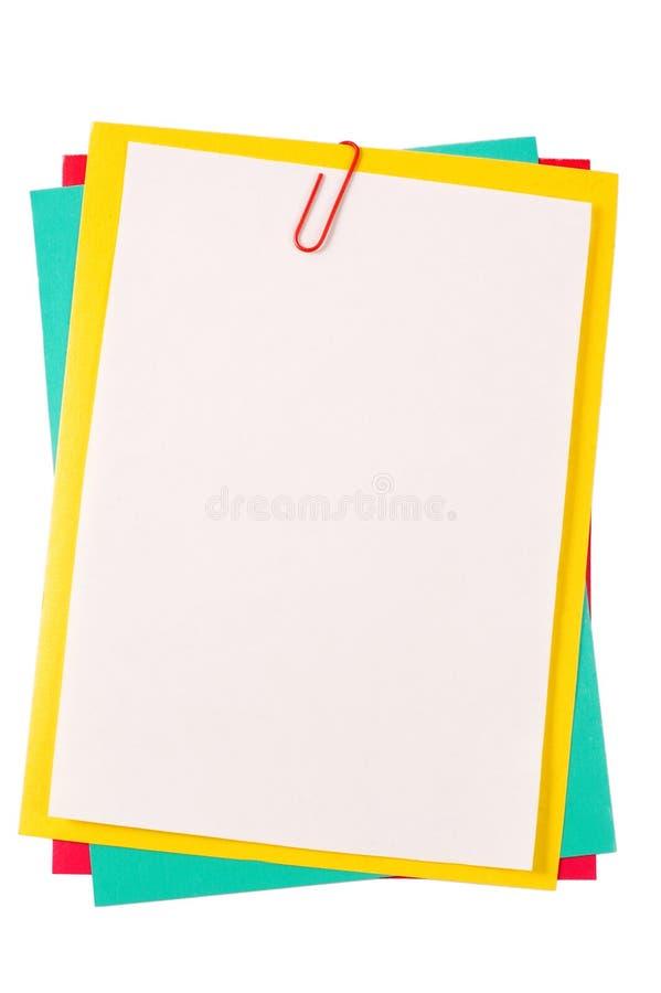 Het document van de kleur met een paperclip stock foto