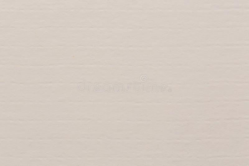 Het document van de kranten het lichte beige textuur lege oude tapijt die van de patroonmuur de achtergrond van de kunstambacht b royalty-vrije stock foto's