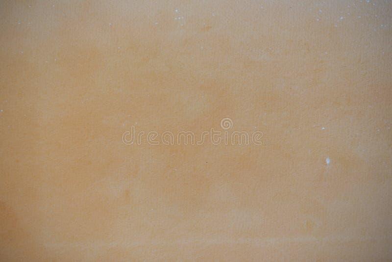 Het document van de kunstenaar met oranje was stock afbeeldingen