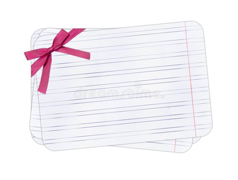 Het document van de nota met rooskleurige boog geïsoleerdet achtergrond stock illustratie