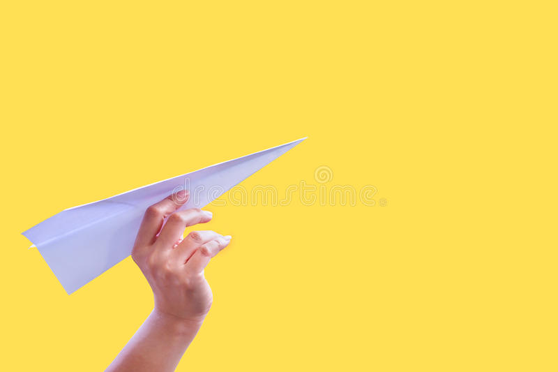Het document van handvliegtuigen vouwen aan succes voor het document van de ontwerpraket stock foto's