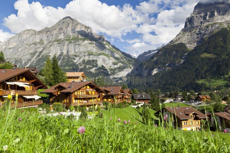 Het dorp van Grindelwald, Zwitserland stock afbeelding