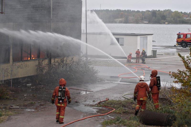 Het doven van de brand stock foto's