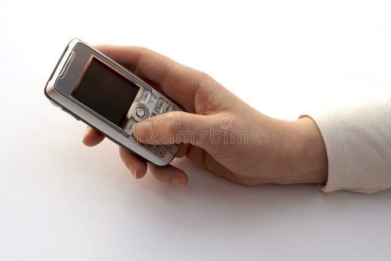 Het draaien van een celtelefoon royalty-vrije stock afbeelding