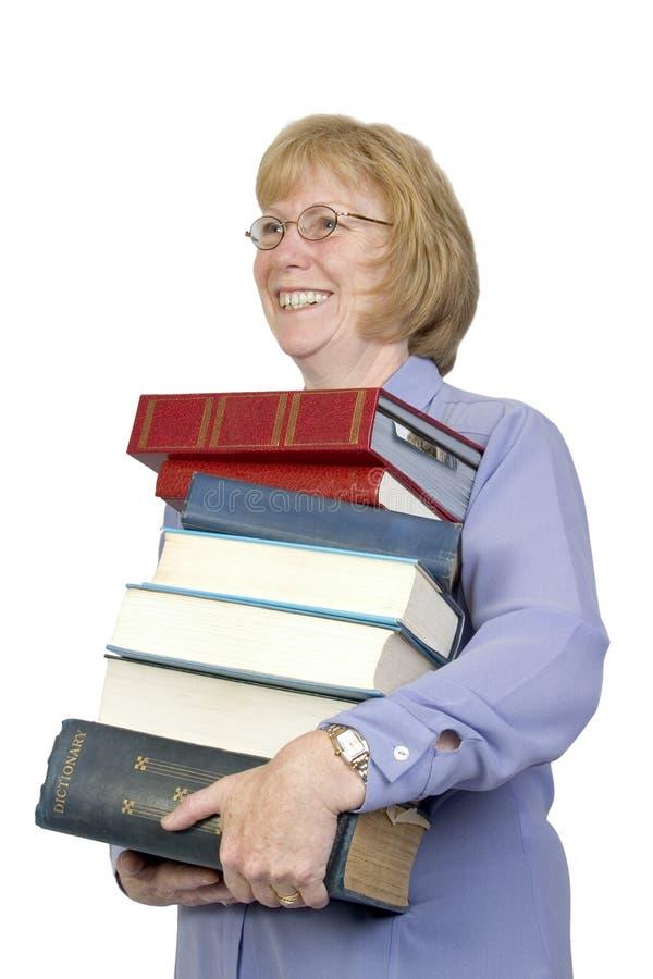 Het dragen van de Boeken stock afbeelding