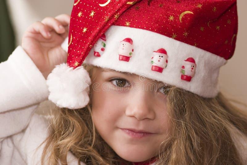 Het dragen van de hoed van de Kerstman royalty-vrije stock afbeeldingen
