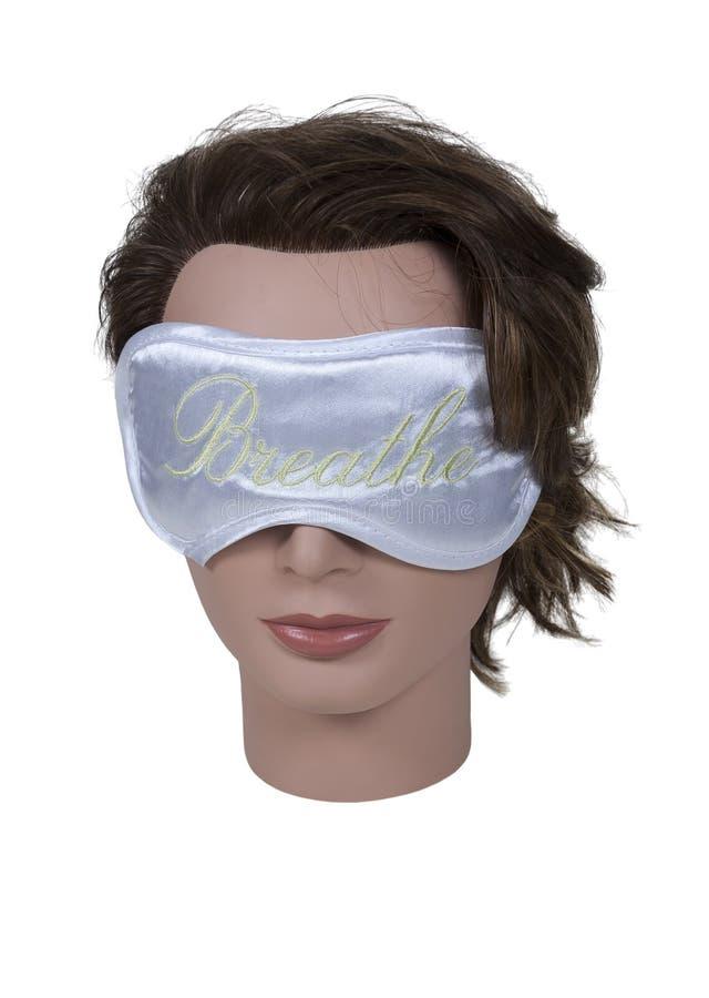 Het dragen van het Masker van de Slaap stock fotografie