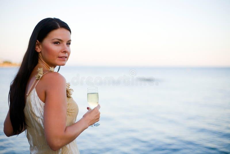 Het drinken Champagne stock foto's