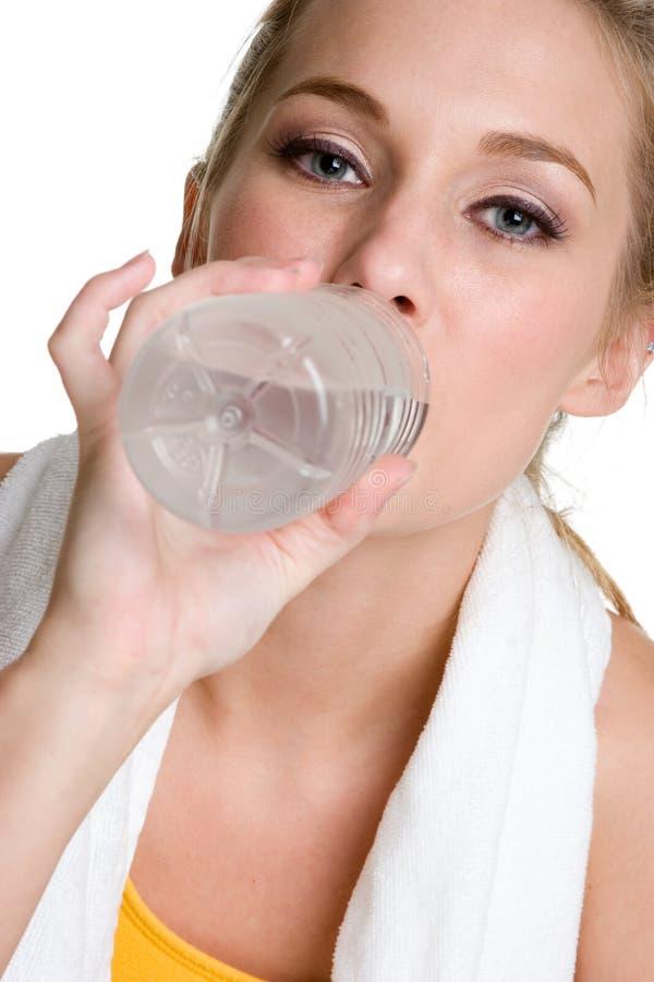 Het Drinkwater van de vrouw stock foto's