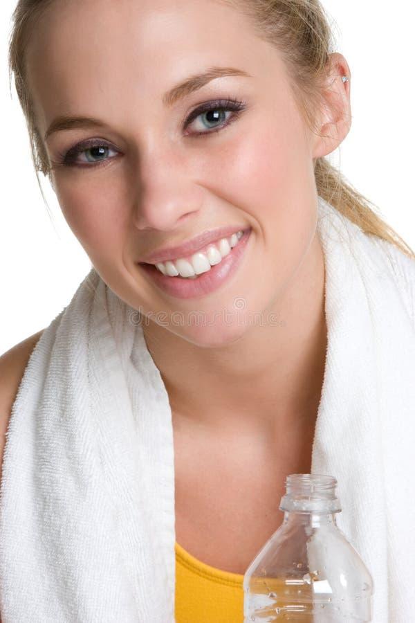 Het Drinkwater van de Vrouw van de geschiktheid stock afbeeldingen