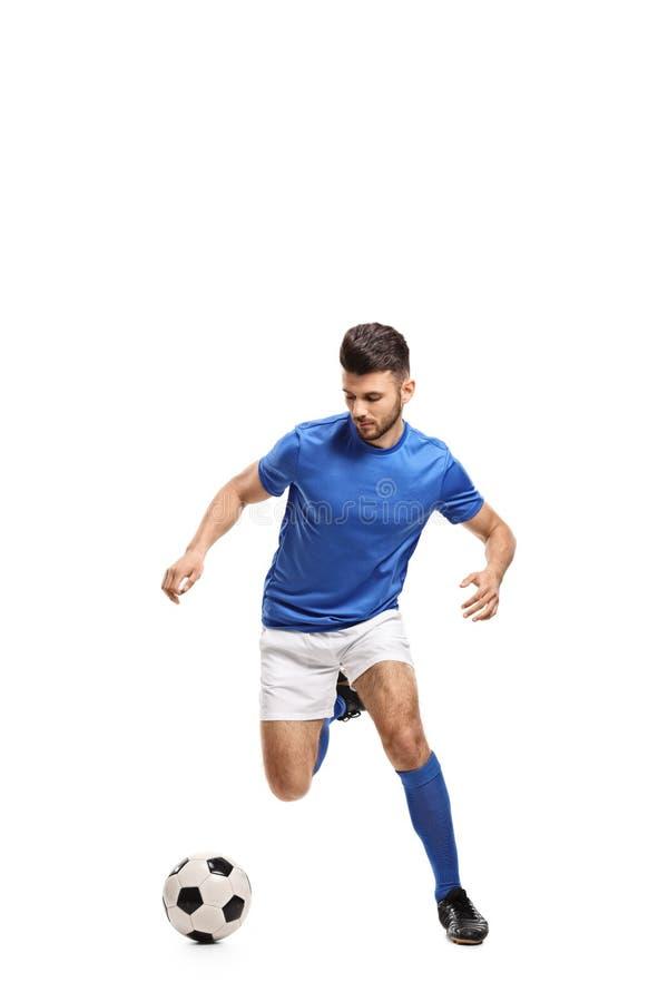 Het druppelen van de voetballer stock afbeeldingen