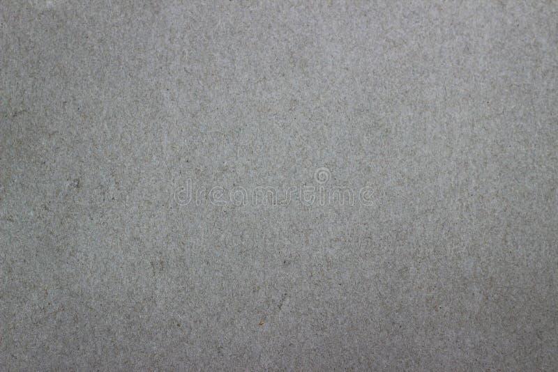 Het duidelijke document is een grijze achtergrond stock foto