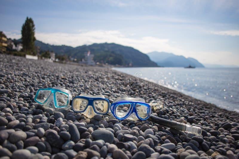 Het duiken het masker op de vakantie van de strandzomer reist tijd royalty-vrije stock afbeeldingen