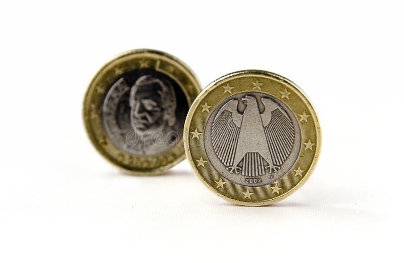 Het Duitse en euro muntstuk van Spanje stock foto's