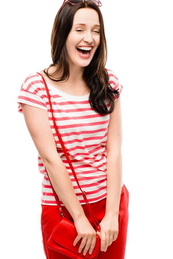 Het dwaze meisje kleedde zich in het rode het lachen glimlachen geïsoleerd op witte bac royalty-vrije stock foto's