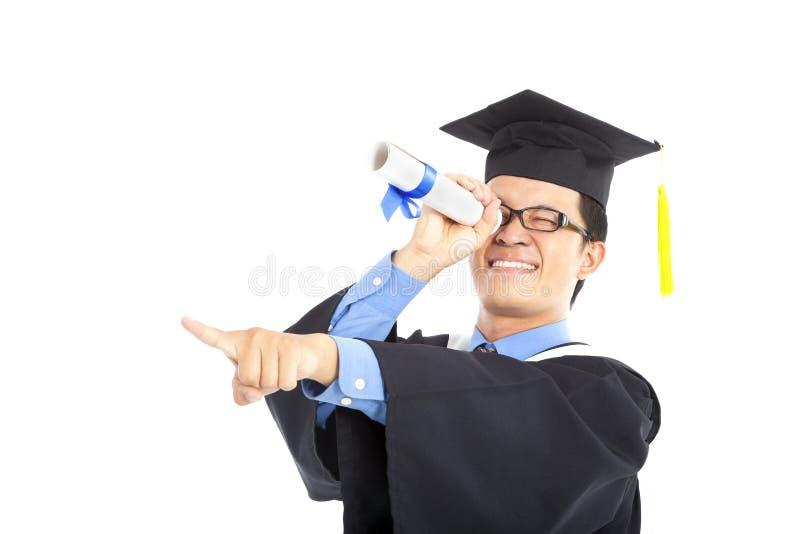 Het een diploma behalen student het letten op royalty-vrije stock fotografie