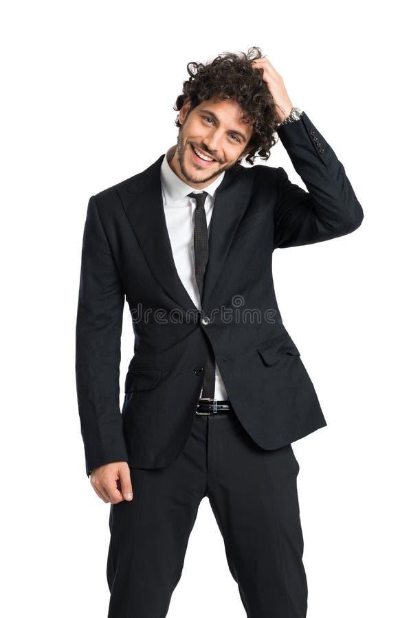 Het elegante Schuwe Mens Glimlachen stock afbeeldingen