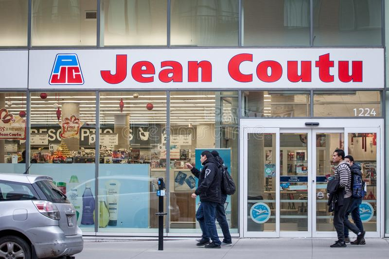 Het embleem van Pharmaciejean coutu op hun hoofdwinkel voor Montreal stock afbeelding