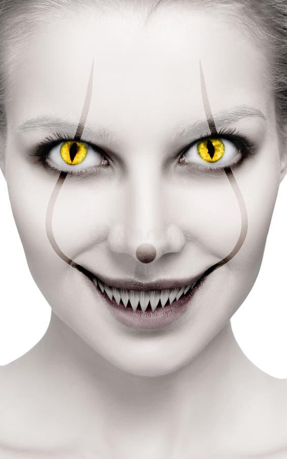 Het enge vrouwelijke gezicht met helloween verschrikking grimm stock afbeeldingen