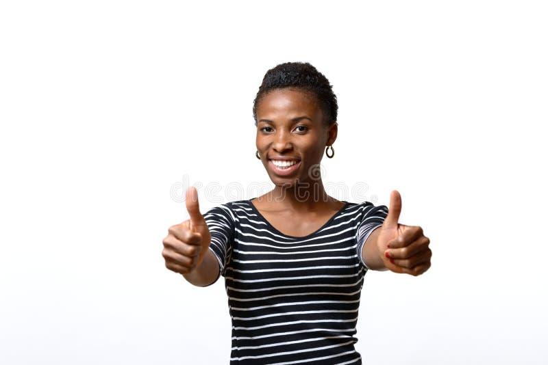 Het enthousiaste gemotiveerde vrouw geven duimen omhoog royalty-vrije stock foto