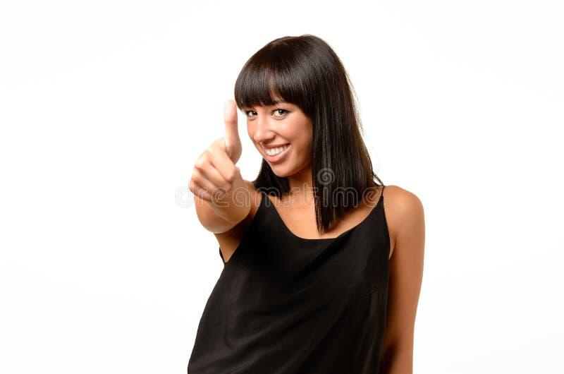 Het enthousiaste gemotiveerde vrouw geven duimen omhoog stock foto's