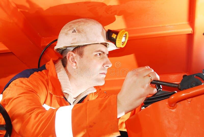 Het ernstige mijnwerker werken stock foto's