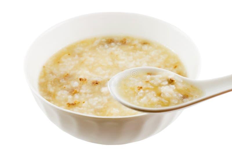Het eten van Congee royalty-vrije stock afbeeldingen