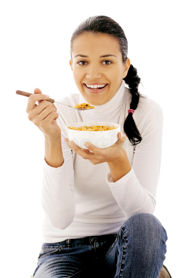 Het eten van cornflakes royalty-vrije stock afbeeldingen