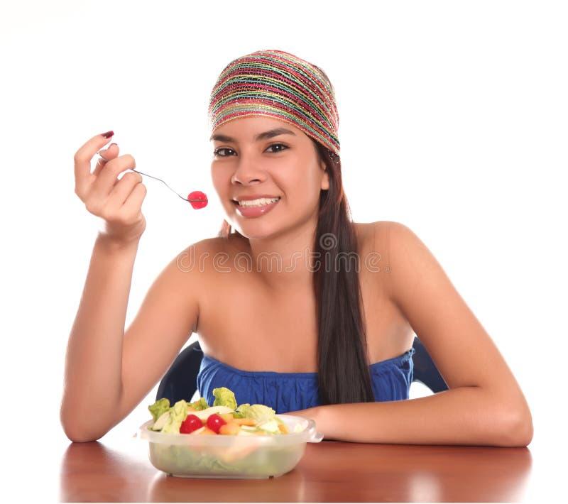 Het eten van de vrouw stock foto