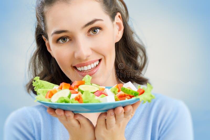 Het eten van gezond voedsel stock afbeelding