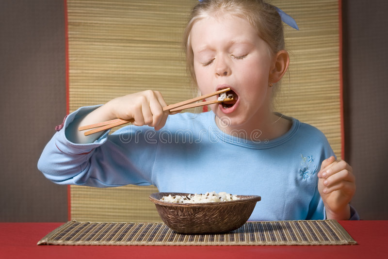 Het eten van rijst royalty-vrije stock fotografie