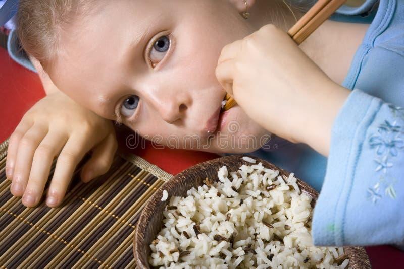 Het eten van rijst stock foto's