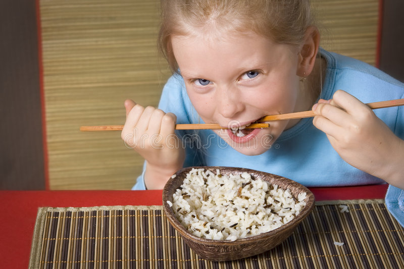 Het eten van rijst stock fotografie